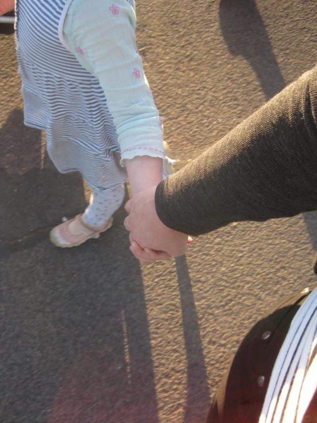 grown up holding hands with a child joy cowley poem bridges