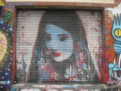 graffiti walk Footscray woman downcast eyes geisha with her hair down