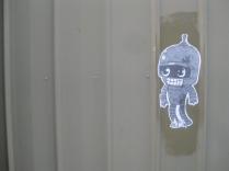 twilight walk home footscray graffiti alien paste up