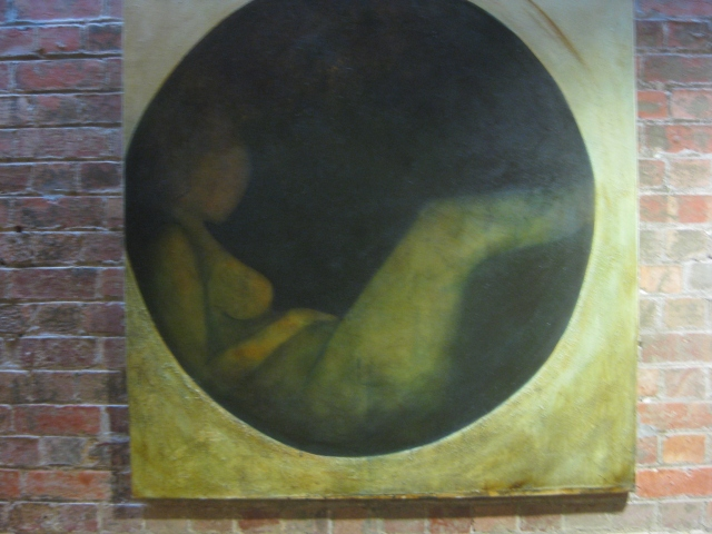 painting of a naked woman in the dark