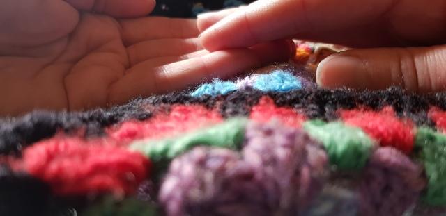 hands touching colourful crotchet balnket talitha fraser nz poet